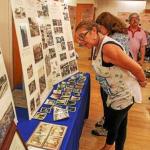 Women observing the Pennhurst exhibit